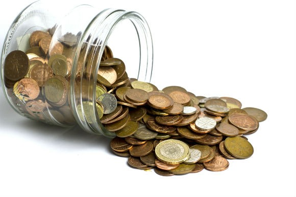 UK Coins pounds in jar RS