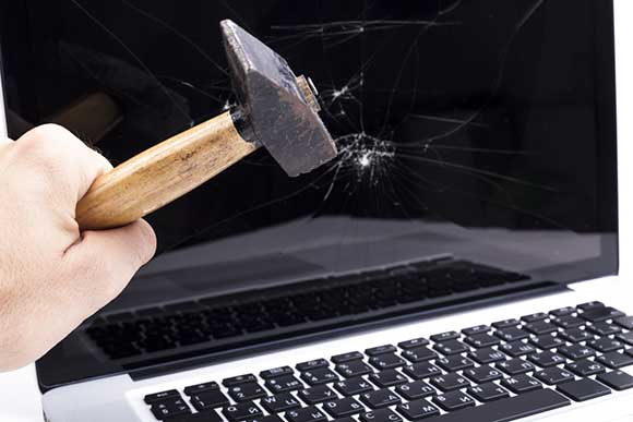 Hammer smashing a computer screen