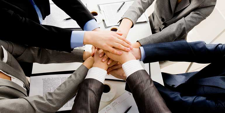 Business people hands in working together