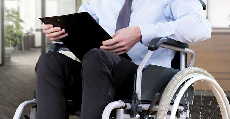 Man in wheelchair with clipboard