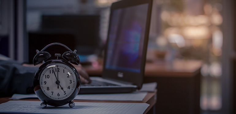 Man staying late at his desk