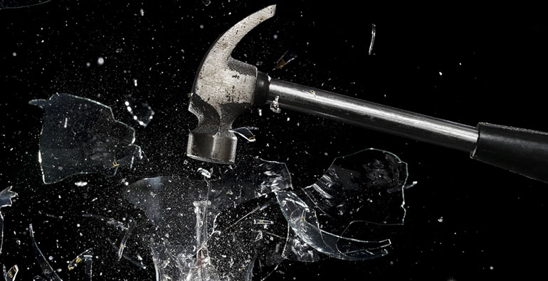 Hammer smashing glass