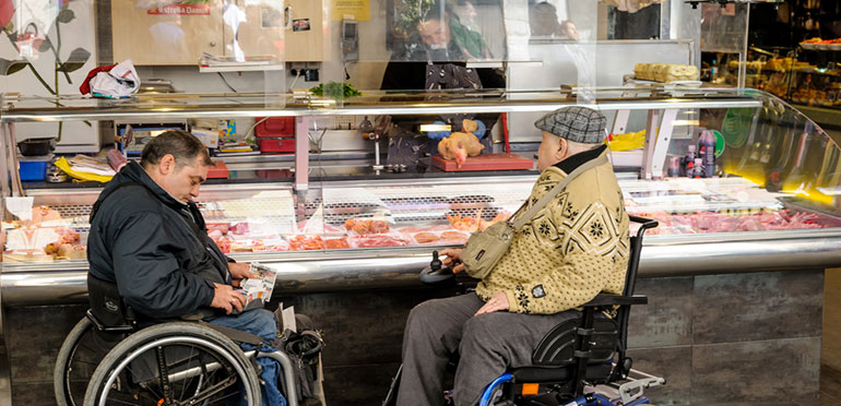 men in wheelchairs at deli