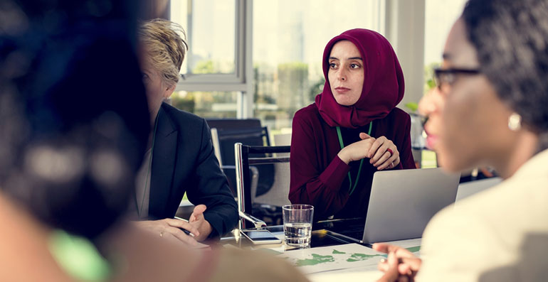 Woman wearing headscarf in workplace