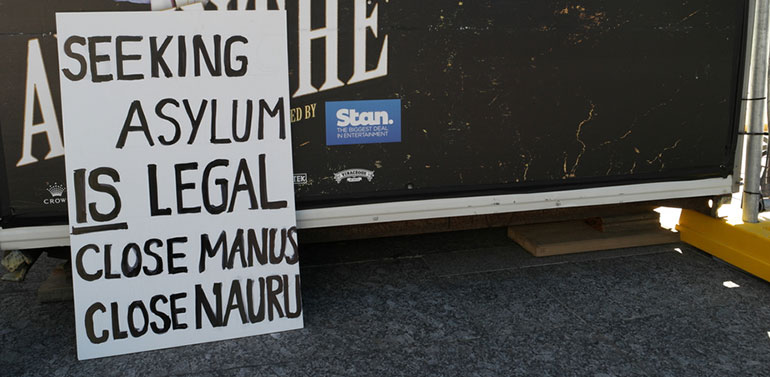 Asylum seeker protest sign