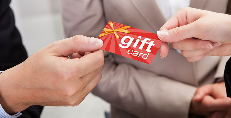 Person giving a gift card