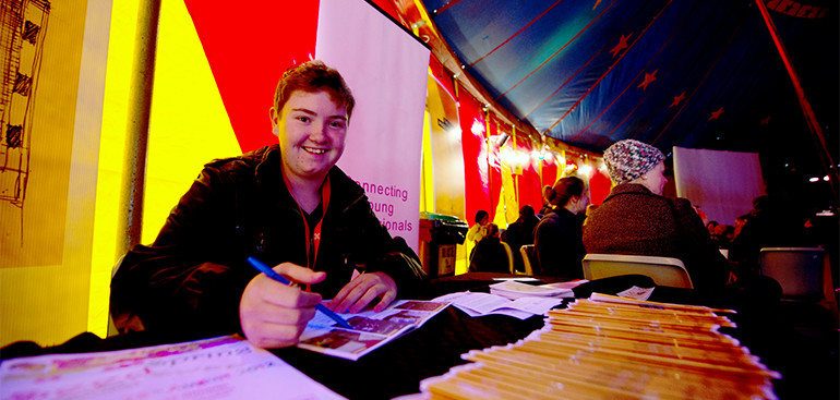 Young volunteer at festival