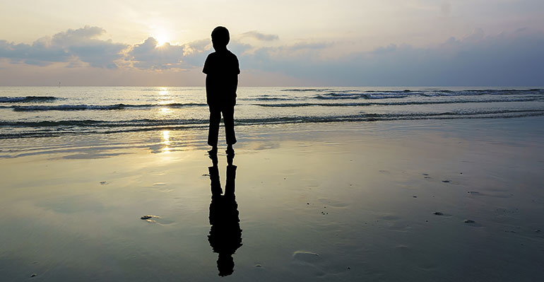 Silhouette of a boy on a beach