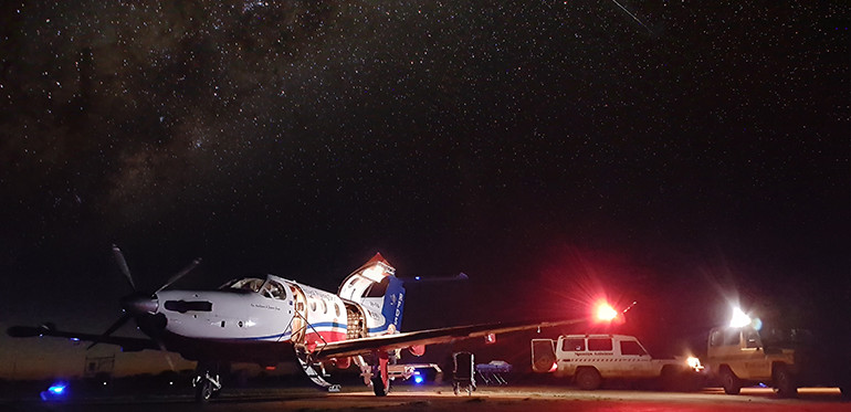 plane on the ground at night