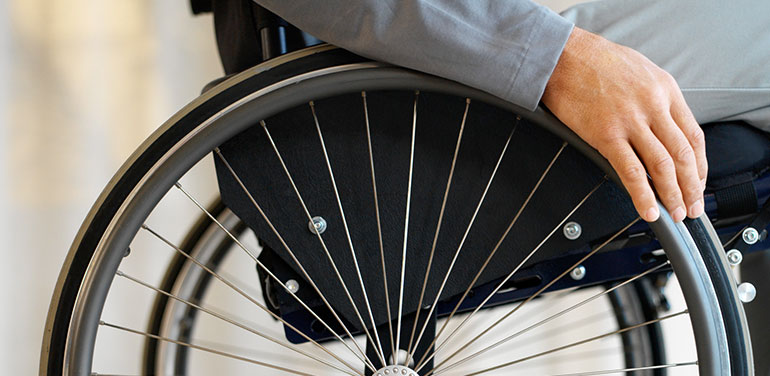 Close up of person in wheelchair