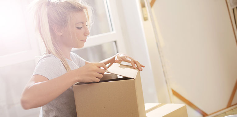 girl packing boxes to move house