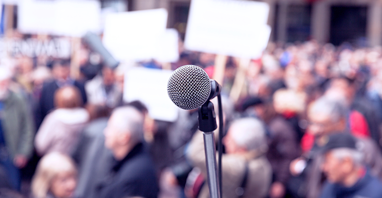 microphone in front of protest