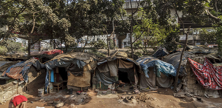 People live in slums just off the tracks in Dhaka Bangladesh
