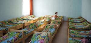 dormitory filled with beds in an orphanage