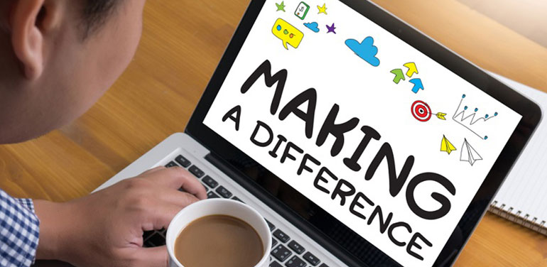 person looking at laptop which says making a difference on it