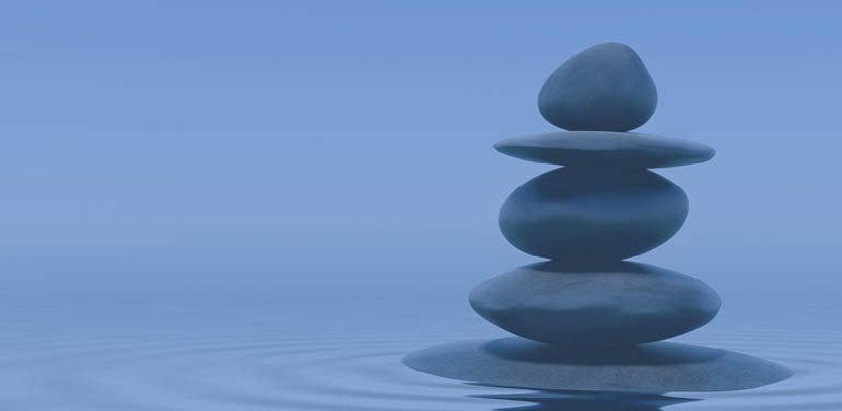 stack of pebbles in water, cover image of Salary Survey