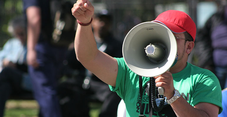 protester speaking into a megaphone