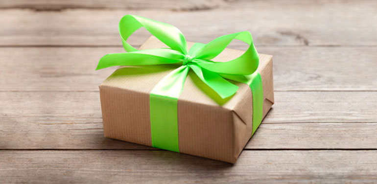 gift tied up with a green ribbon