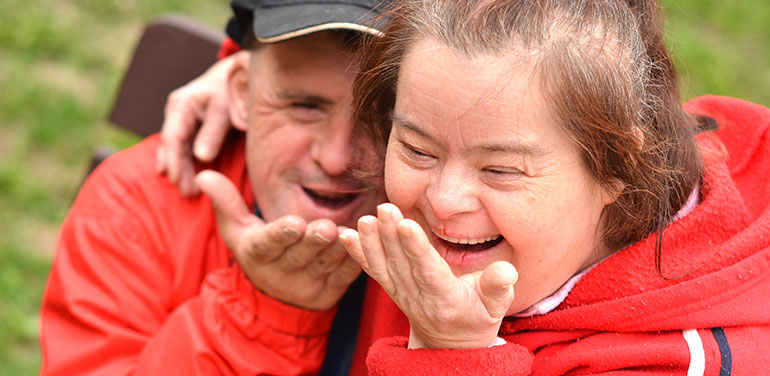 couple with disability blowing a kiss