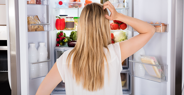 Woman in front of fridge