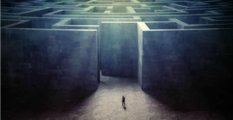 A tiny person entering a maze