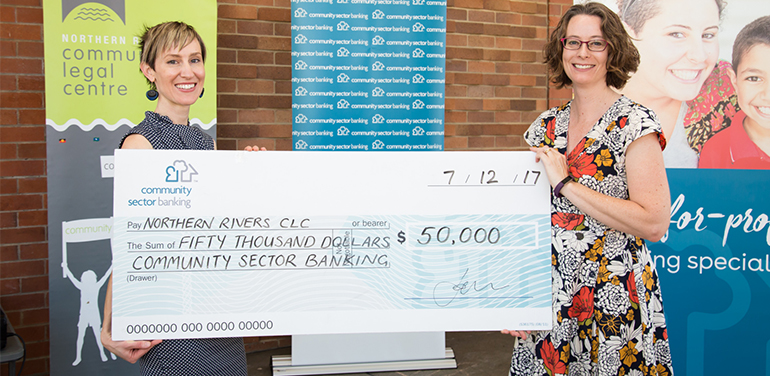 Two women holding big cheque