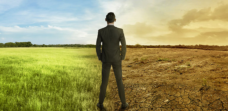 businessman looking at the effects of climate change