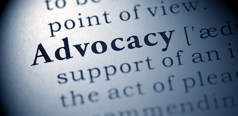 close up of dictionary definition of advocacy