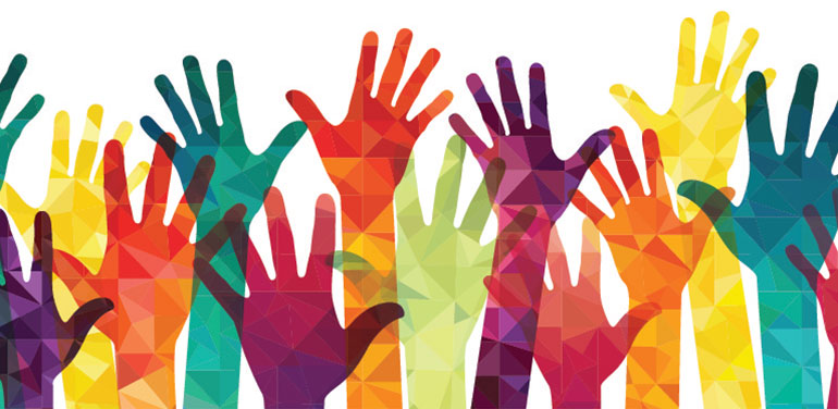 Image of colourful hands in the air