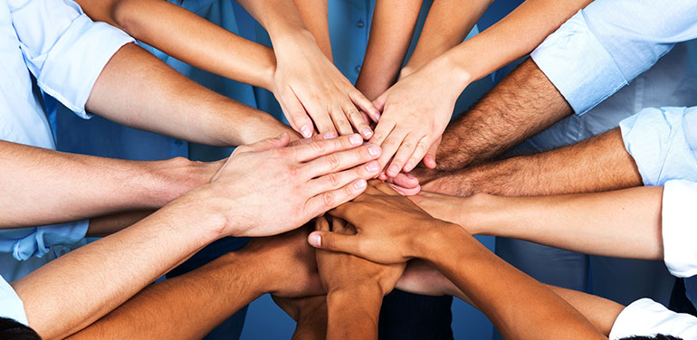 Group of hands in the middle of a circle