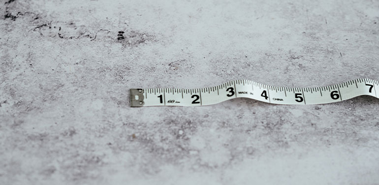 Tape measure on a grey background