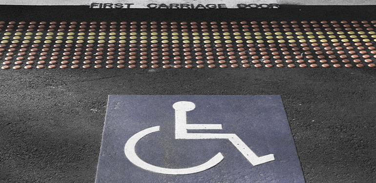 wheelchair sign on tram stop