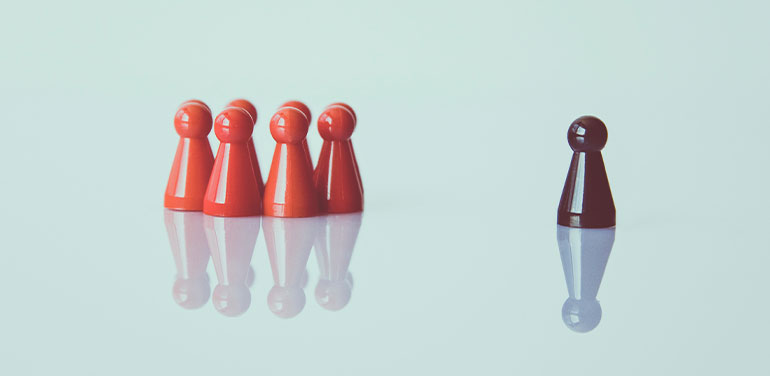 group of pawns one separate showing leadership