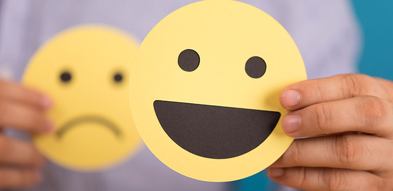 person with happy face and sad face