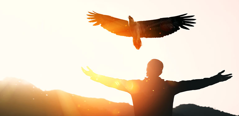 man outstretched arms with eagle