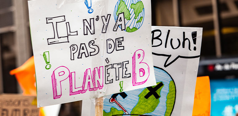 Sign at a climate march in Montreal.