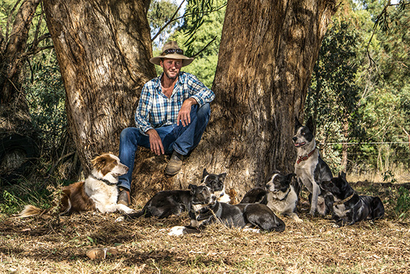 Bernie and dogs under a tree. Photo: Clayton Rose.