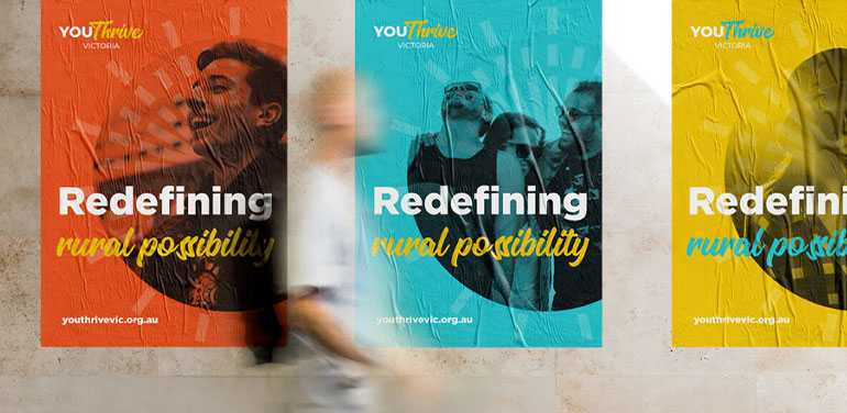 Blurred image of person walking past Youthrive posters