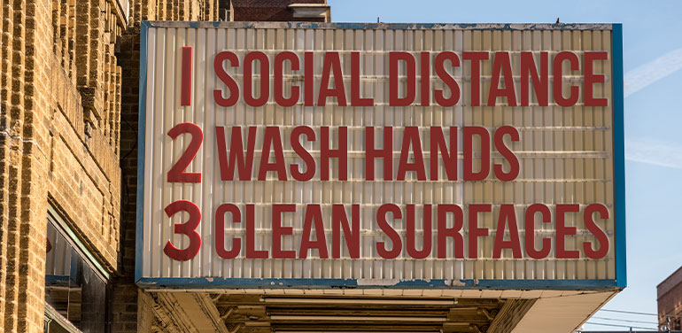 a movie cinema billboard with three basic rules to avoid the coronavirus epidemic of wash hands, maintain social distance and clean surfaces