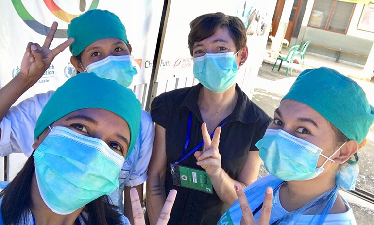 Four members of staff at Maluk Timor wearing face masks