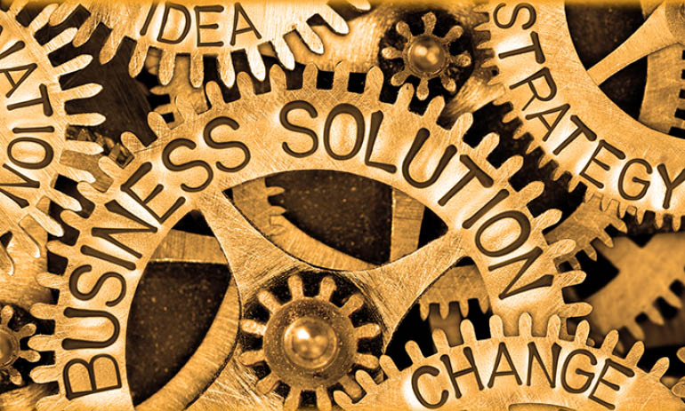 cogs with words on them including 'change' and 'business solution'