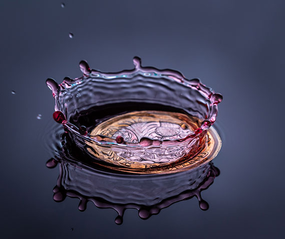 a coin splashing in water