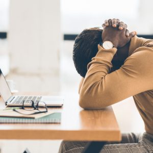 Stressed worker suffering burnout