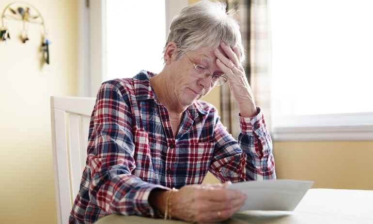 Older person stressed about bills
